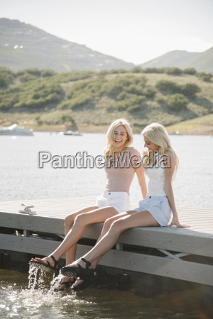 portrait of two blond sisters sitting