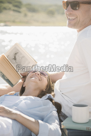 man and woman reclining on a