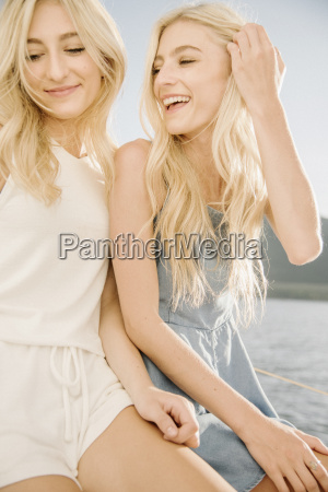 portrait of two blond sisters on
