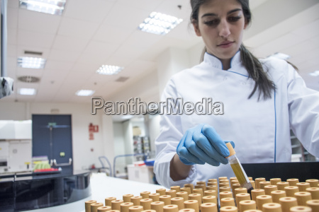 laboratory technician in analytical laboratory with