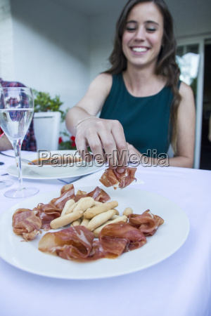 woman taking a piece of spanish