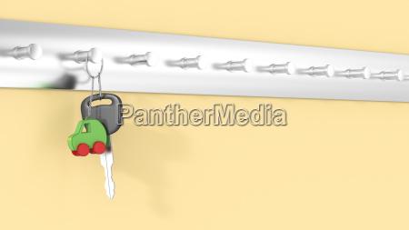autoschluessel mit schluesselanhaenger der an schluesselhaken