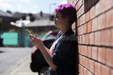 young woman with dyed hair leaning
