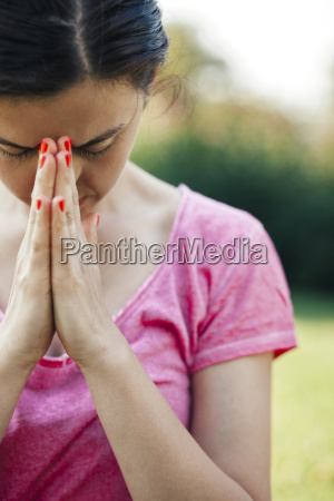 young woman meditation outside in the