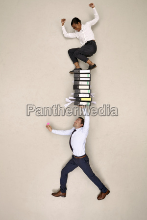 businessman holding folders with female colleague