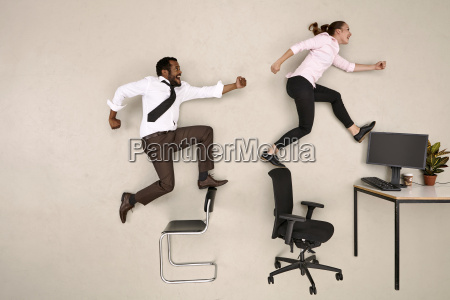 business colleagues walking on chairs towards