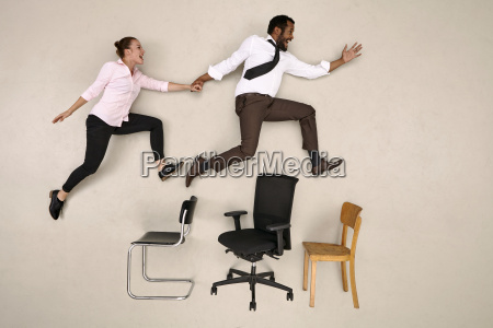 businessman jumping with his female colleague
