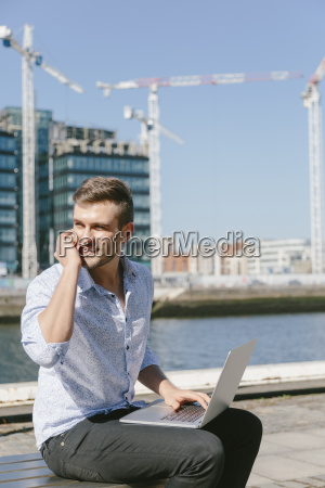 ireland dublin smiling young businessman sitting