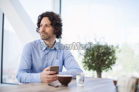 portrait of man with smartphone and