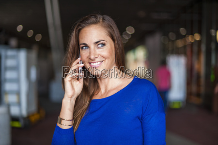 smiling brunette woman on cell phone