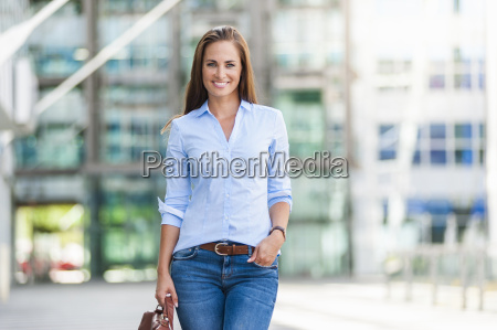 portrait of smiling brunette woman standing