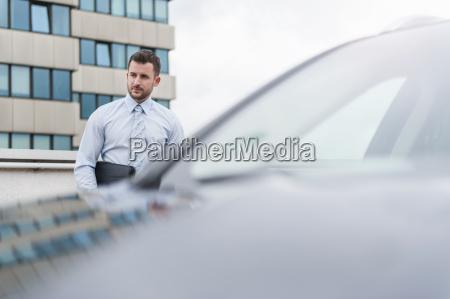 businessman at car on parking lot