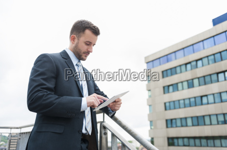 businessman looking at digital tablet in