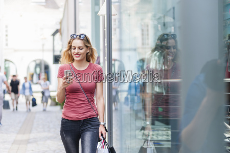 smiling woman walking on the street