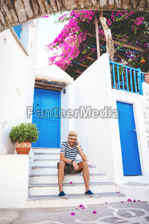greece amorgos island young man sitting