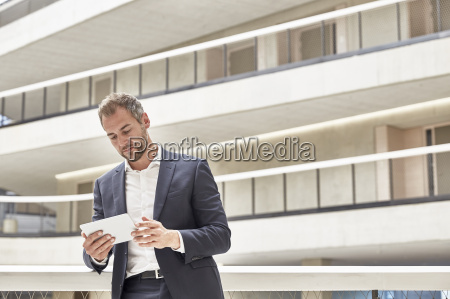 businessman using tablet in office building