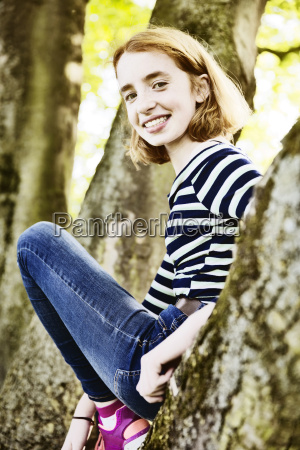 portrait of smiling girl climbing on