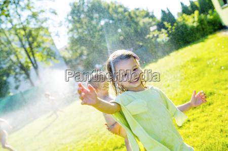 little girl having fun with lawn