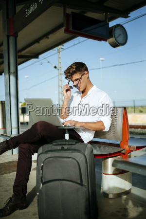 young man using a laptop at
