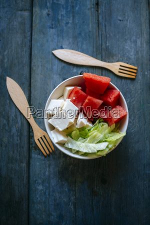watermelon salad lettuce and cheese served