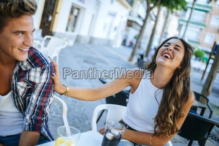 young couple having fun at sidewalk