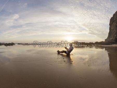 portugal senior man sitting at beach