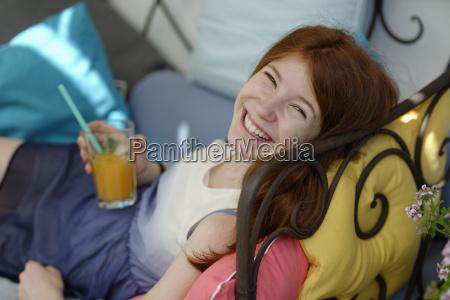 portrait of happy teenage girl sitting