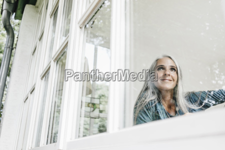 smiling woman at home looking through