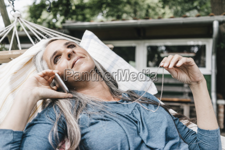 smiling woman on the phone lying
