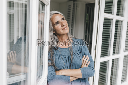 portrait of smiling woman leaning against