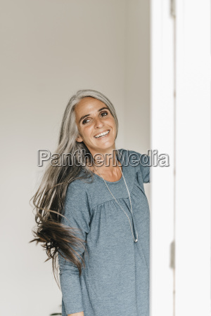 portrait of smiling woman tossing her