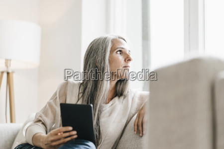 woman with with e book sitting
