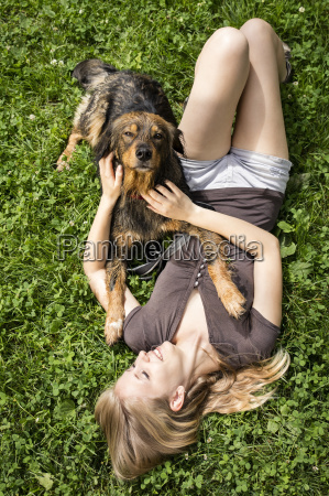 young woman relaxing with her dog