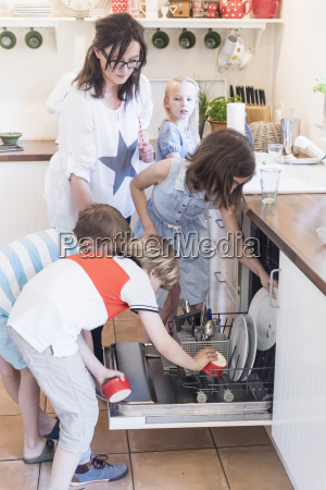mother and four children loading the