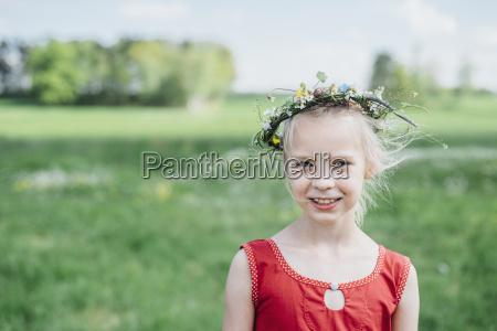 portrait of smiling girl wearing flower