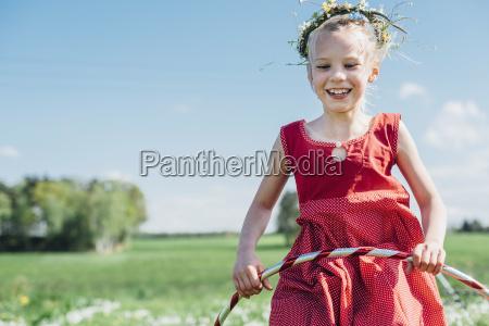 happy girl with hula hoop wearing