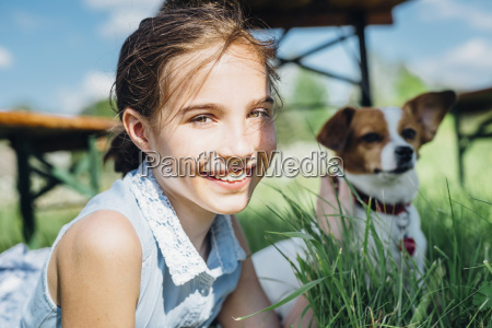 portrait of smiling girl with dog