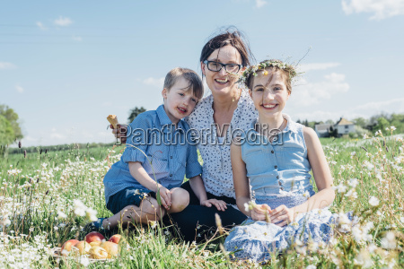 mother and two children relaxing in