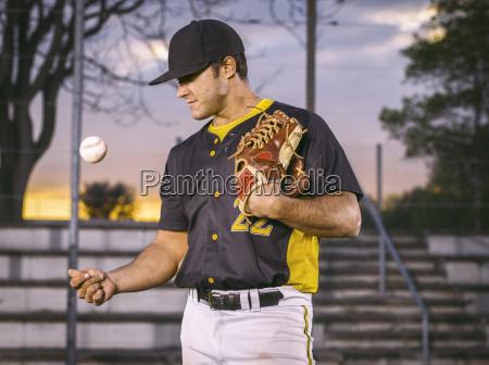 baseball player throwing up ball