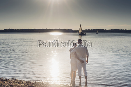 couple standing at lake cospuden in