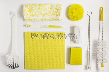 yellow cleaning utensils on white background