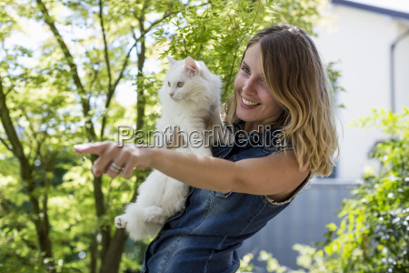 smiling woman with her cat in