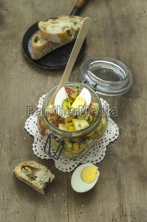 jar of potato salad with tomatoes