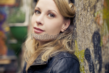 portrait of blond woman leaning against