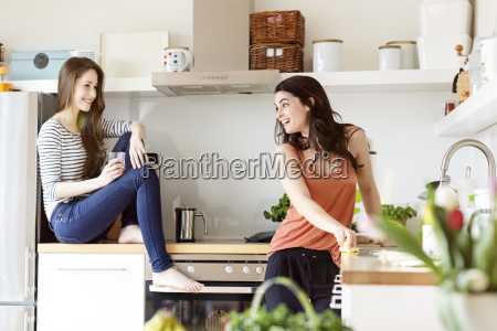 two happy women in kitchen