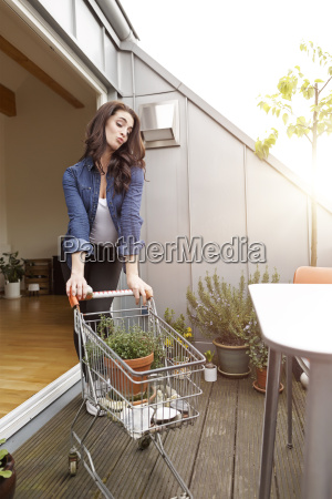 young woman with potted plant in