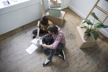 couple sitting on floor of new