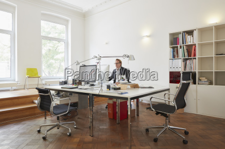 businessman sitting at desk in an