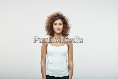 portrait of smiling redheaded woman with