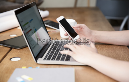 woman at desk using laptop and